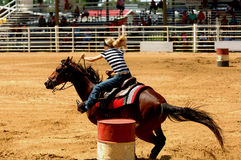 Barrel Racing. A young woman barrel racing at a rodeo Royalty Free Stock Photo