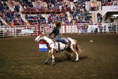 Barrel Racing. HARRISBURG, PENNSYLVANIA - JANUARY 5 : An unidentified rider competes in the barrel racing event at the Farm Show Complex on January 05,2013 in Royalty Free Stock Photography