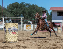 Barrel Racing. Action at the Cottonwood Rodeo in northern California Royalty Free Stock Photography