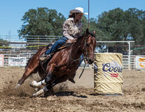 Barrel Racing Action. At the Cottonwood Rodeo in northern California Royalty Free Stock Image