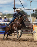 Barrel Racing. Action at the Cottonwood Rodeo in northern California Royalty Free Stock Photo