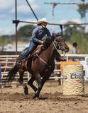 Barrel Racing Cowgirl. Barrel racing action at the Cottonwood Rodeo in northern California royalty free stock photo