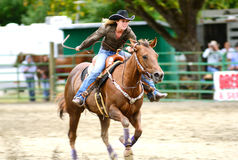 Barrel Racing. MYRTLE CREEK, OR - JUNE 12: Barrel Racing event at the South Douglas Rodeo. June 12, 2011 in Myrtle Creek, OR Stock Photography