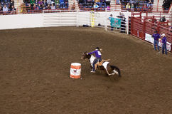 Barrel Racing at State Farm Show. HARRISBURG, PENNSYLVANIA - JANUARY 7: A young rider participates in the barrel racing event at the Farm Show Complex on January Stock Photo