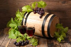 Barrel with red wine stock images