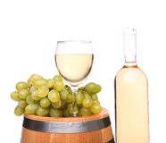 Barrel, ripe grapes, glass and bottle of wine Stock Photos