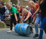 Barrel rolling race. Beer, Devon, UK.14th August 2018: Famous barrel rolling race in main street of Beer during annual Beer Regatta Week event. Four members of royalty free stock images