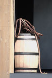 Barrel and rope. Barrel of gunpowder and old rope Stock Photo