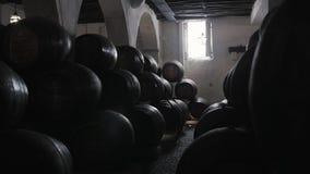 Barrel rows in a winery, wine porto barrels stock on old factory, porto, portugal. Barrel rows in a winery stock footage
