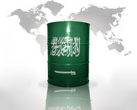 Barrel with saudi arabia flag. On the world map background Stock Photo