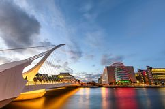 Samuel Beckett Bridge Dublin Ireland. Barrel shaped Dublin Convention Center and Samuel Beckett Bridge reflecting in the river Liffey, Dublin , Ireland Stock Photography