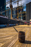Barrel and ship at Pier 15, at South Street Seaport in Manhattan Stock Photo