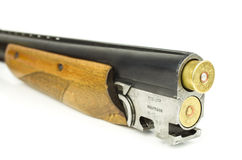 Barrel shotgun. And cartridges on a white background Royalty Free Stock Photography