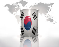 Barrel with south korea flag. On the world map background stock photo