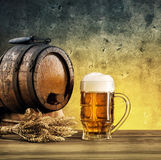 Barrel on stand and mug of beer Royalty Free Stock Image
