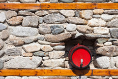 Barrel in a Stone Wall Stock Photography