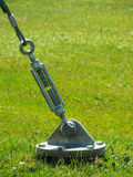 A barrel strainer anchored in grass. Royalty Free Stock Photography