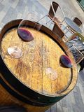 Barrel table with two glasses of wine. Barrel table with two glasses of red wine stock photos