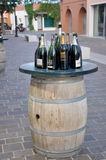 Barrel table with wine at the street Royalty Free Stock Image