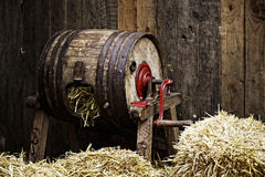 Barrel-type butter churn filled with straw Stock Photography
