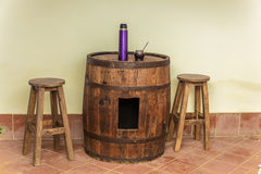Barrel used as table with mate Stock Image