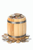 Barrel with various coins Stock Photography