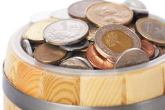 Barrel with various coins Royalty Free Stock Photography