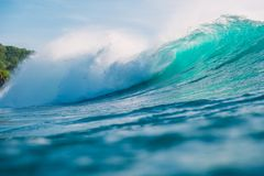 Barrel wave with sun light. Crashing blue wave in ocean. Barrel wave with sun light. Crashing blue wave in sea royalty free stock photography