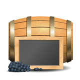 Barrel with wine and blackboard in the foreground Royalty Free Stock Photo