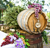 Barrel of wine with grape cones. On natural background stock photos