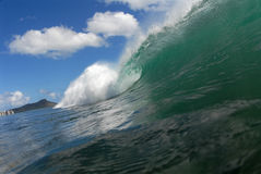 Barreling wave. A beautiful barreling wave in Hawaii with Diamond Head in the background royalty free stock images