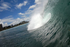 A barreling wave. A beautiful barreling wave in Honolulu, Hawaii Royalty Free Stock Image