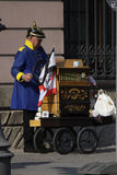 Barrell organ playeer. CIRCA MARCH 2014 - BERLIN: a man in a Prussian uniform and a Pickelhaube playing a barrell organ in the Mitte dristrict of Berlin royalty free stock images