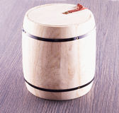 Barrell over wood. Barrel of lite wood over table, square image royalty free stock image