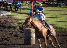 Barrell Racer. A female competitor in the barrel racing competition, at the Hairy Hill Rodeo, Hairy Hill, Alberta, July 5, 2014 royalty free stock images