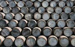 Barrels. Whiskey barrels stacked at an old distillery Royalty Free Stock Image