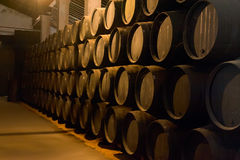 Barrels. Old wooden barrels of sherry in bodega of Spanish town of Jerez de la Frontera Stock Photo