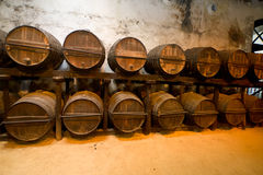 Barrels. Old wooden barrels of sherry in bodega of Spanish town of Jerez de la Frontera Royalty Free Stock Photography