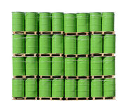 Barrels. Bunch of green barrels stacked on pallets Royalty Free Stock Photography