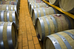 Barrels. View of an interior of a wine cellar with racks of barrels Stock Photo