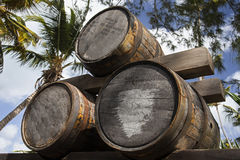 Barrels of alcohol. Three barrels of alcohol in a tropical setting Royalty Free Stock Images