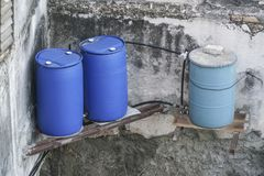 Barrels as a water storage in Cuba. Blue plastic barrels as a water storage in Cuba Royalty Free Stock Image