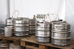 Barrels of beer. Steel indutrial barrels of beer stocked in storage Royalty Free Stock Photos