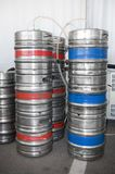 Barrels of beer. Steel indutrial barrels of beer stocked in storage Stock Image