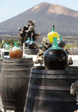 Barrels and  big bottles with grape wine - malvasia.  Lanzarote. Spain Royalty Free Stock Images