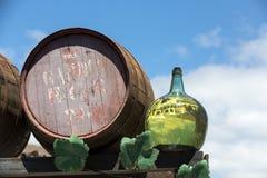 Barrels and  big bottles with grape wine - malvasia. Lanzarote, Spain Stock Photos