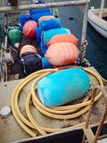 Barrels on a boat. Multi-coloured barres on a boat in port royalty free stock photography