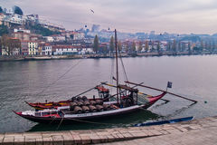Barrels cargo on a boat. Oporto, December 2012. A boat docked at Douro river loaded with barrels.. Vila Nova de Gais on background Royalty Free Stock Images