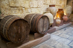 Barrels and ceramic vases in the kitchen area of the Inquisitor` Stock Images