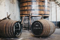 Barrels of Clynelish whiskey inside Brora Distillery, Scotland. The distillery closed in 1983 and is currently being refurbished to reopen in 2020 stock photography
